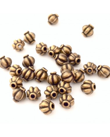 x4 perles métal  citrouille 5mm